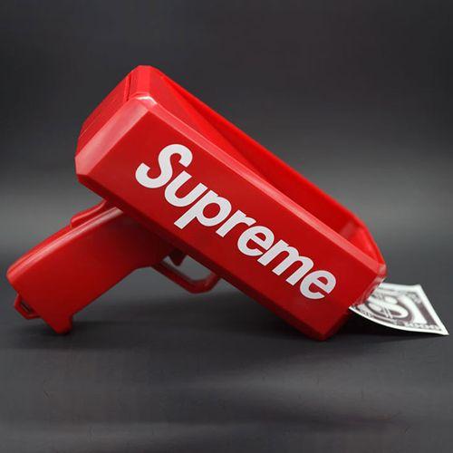 Súng bắn tiền Supreme - Tặng 1 xấp tiền giấy